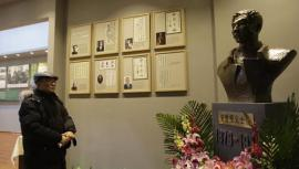A visitor looking at exhibits at the Chinese memorial to the Korean assassin who killed Japan's first PM. © AFP